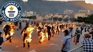 Most people performing full body burns - Guinness World Records