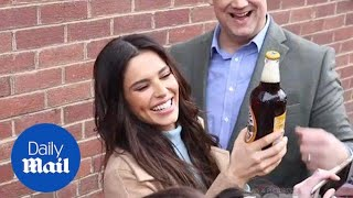 Cheryl handed bottle of brown ale by fan in Newcastle - Daily Mail
