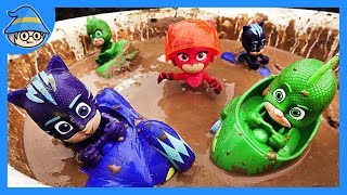 PJ Masks car is in the mud. PJ Masks in water and sand.