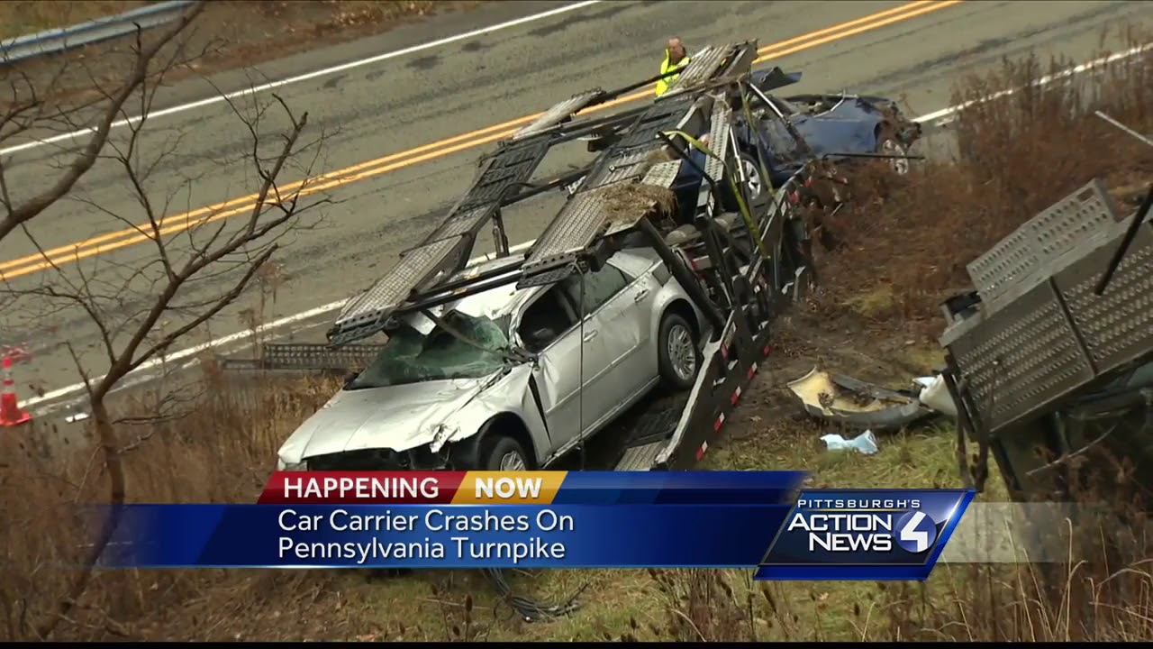 Car carrier goes off Pennsylvania Turnpike, leaving vehicles strewn across  hillside