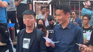 黄之锋、梁继平纽约时报广场高歌愿荣光归香港