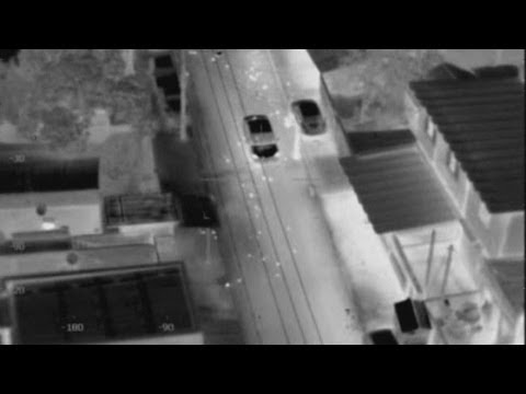 Dramatic helicopter shootout and car chase in Rio de Janeiro
