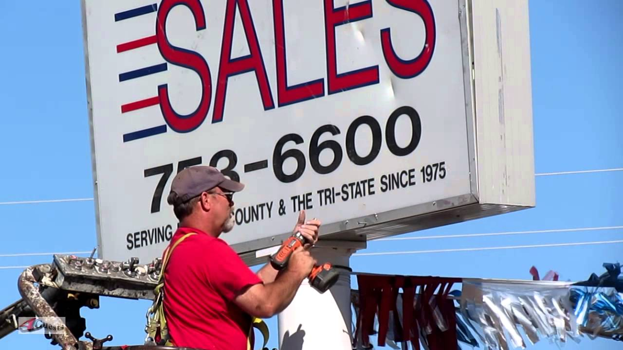 arizona sign company, workers installing route 66 auto sales sign