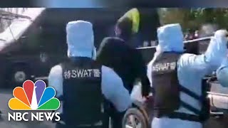Chinese Police Video Shows SWAT Team Drill For Controlling Coronavirus Suspect | NBC News