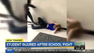 Girl hospitalized after school fight caught on video