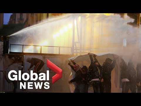 Police fire tear gas, water cannon in clash with anti-government protesters in Beirut