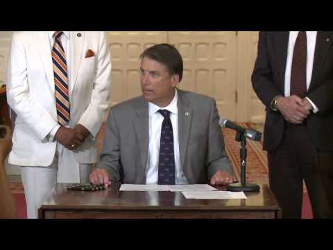 Charles Belk and NC Governor Pat McCrory speaking at the NC Bill Signing Ceremony (8/6/15)