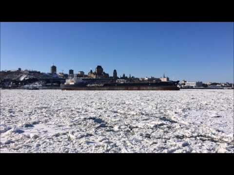 Empty oil tanker sailing through St. Lawrence ice near Quebec City