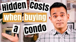 What are the hidden or additional costs when buying a condo?
