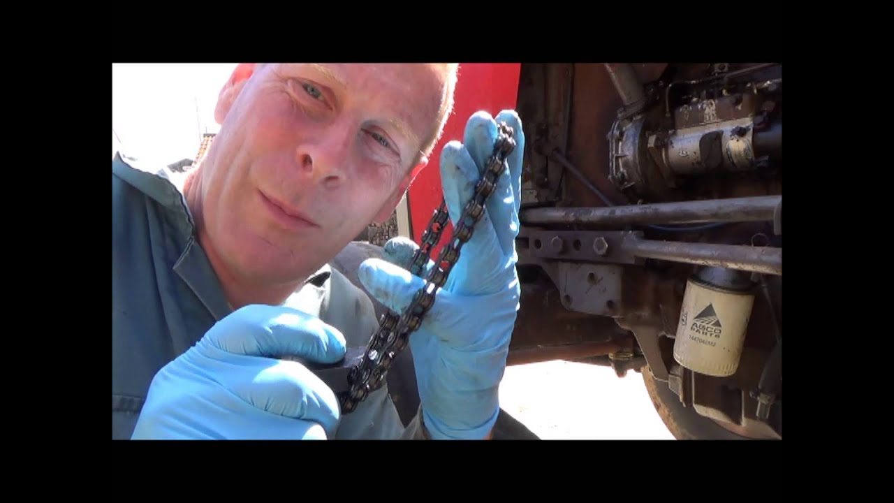 Changing The Oil Filter On A Massey Ferguson 265 Tractor