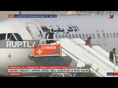 LIVE from Malta airport after plane lands in suspected hijacking