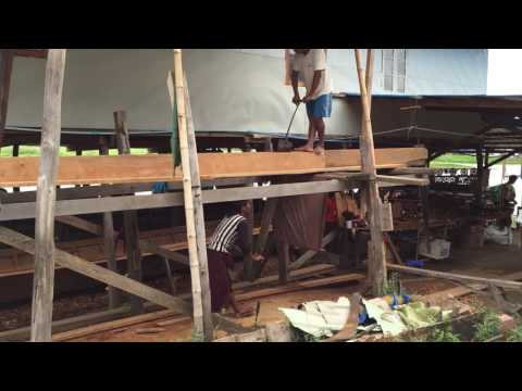 Manually Sawing Planks for Boat Building on Inle Lake in Myanmar