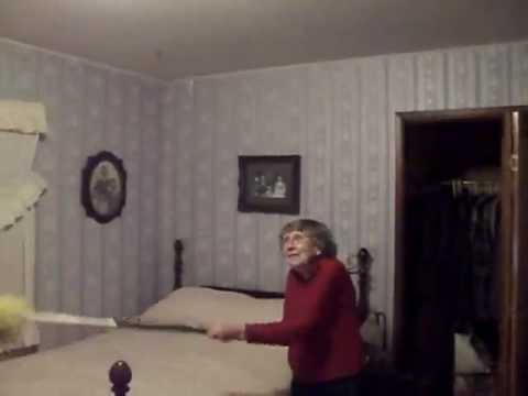 A lady demonstrates how to get a bat out of your house. - YouTube