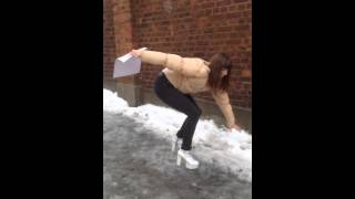 Lady with heels sliding down ice