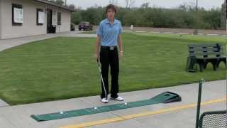 Monica Stratton demonstrates the SKLZ Accelerator Pro Putting Mat