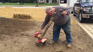 Using a Mantis Tiller/Cultivator to prepare lawn area for planting grass seed.