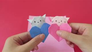 Origami Holding a heart