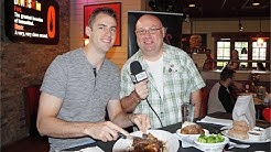 Orlando Magic's Jason Smith attempts the Smokey Bones 2lb Steak Challenge