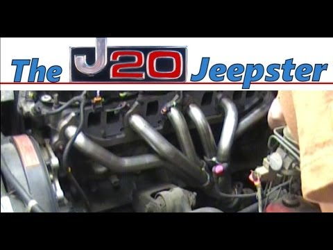 Jeepster installing new exhaust manifold on a Cherokee xj