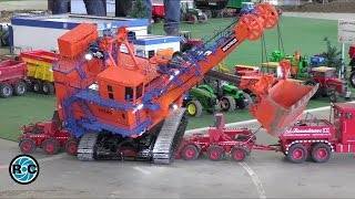 Large RC excavator transported on heavy duty R/C truck