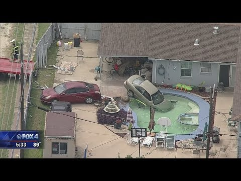 Car winds up in Arlington home's pool after wreck