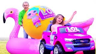 Katy and papa playing with LOL Giant Balls