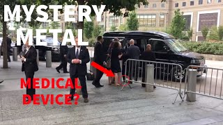 Mysterious piece of metal flings out of Hillary's pant leg