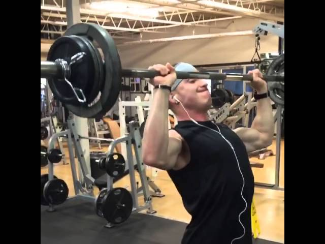 Standing barbell military press with 155 lbs!