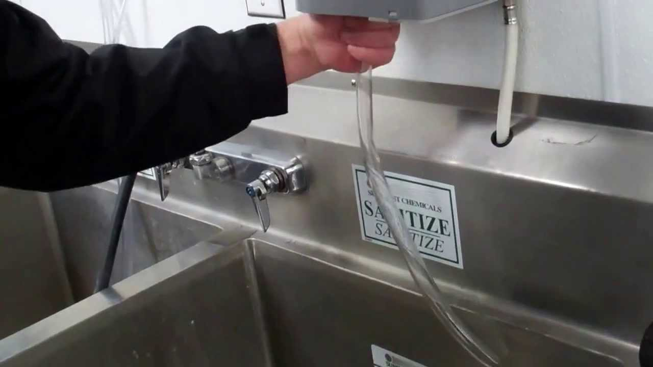 Sunburst Chemicals   Installing The P4C Dispenser Over The 3 Bin Sink