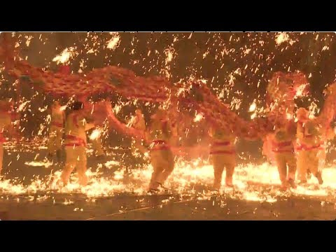 dragon dance in splashing molten iron adds to new year atmosphere in