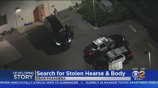 Search Continues For Stolen SUV With Casket, Woman's Body Inside
