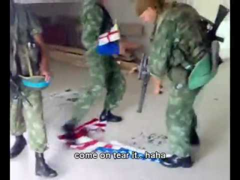 Russian soldiers burning flag of the United States