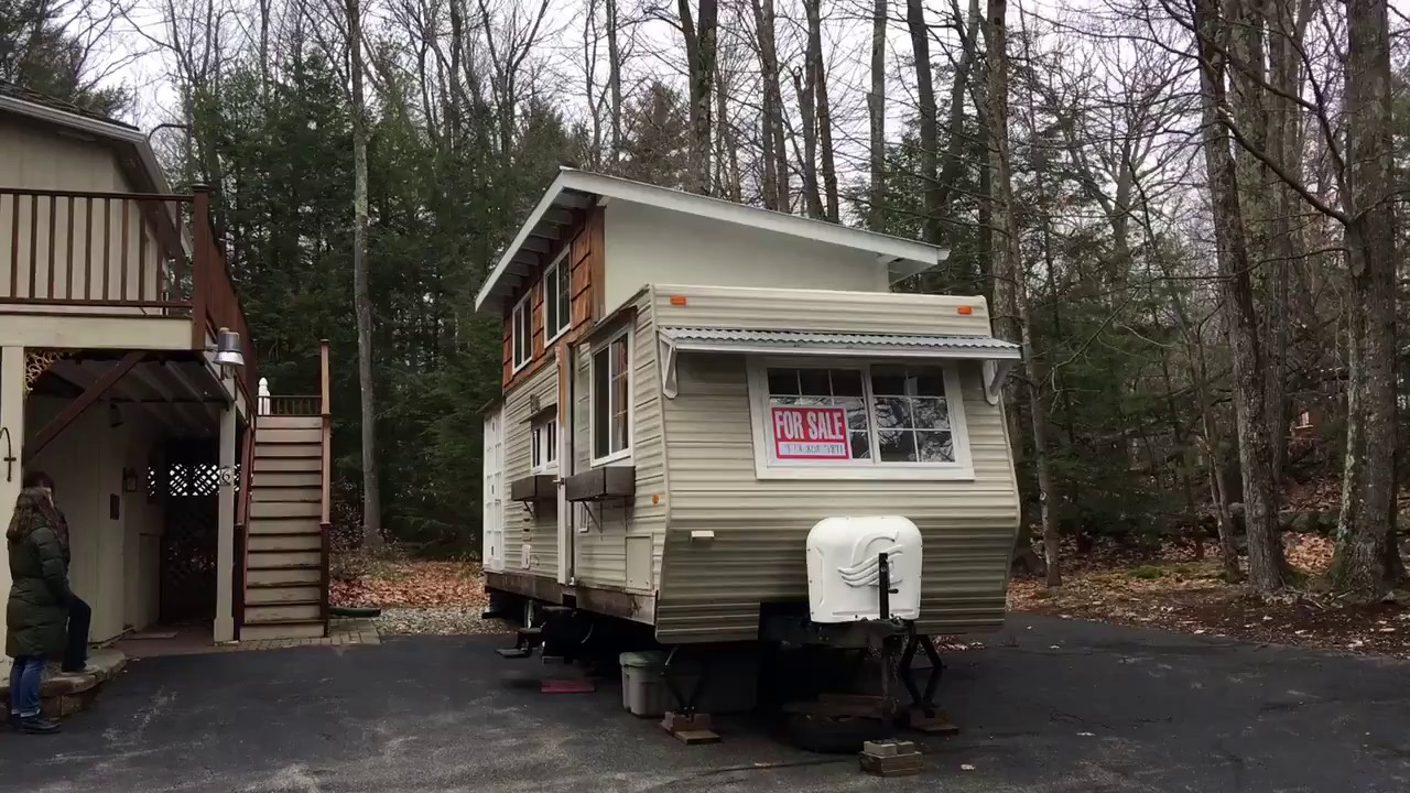 Tiny house with loft built from a travel trailer youtube for Small homes built on trailers