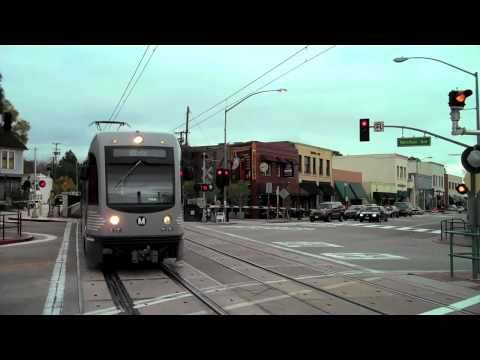 Railroad Crossing Gates - Metro train pulling into Mission St