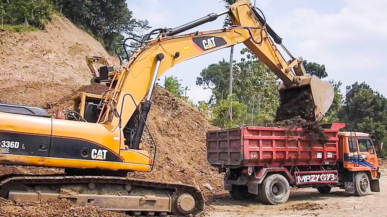 Download Big Digger Large Excavator And Dump Truck Moving Dirt