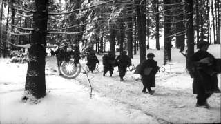US Army 75th Infantry Division, 289th Regiment soldiers advance through snow cove...HD Stock Footage