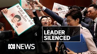 Carrie Lam booed out of Parliament by MPs wearing Xi Jinping masks | ABC News