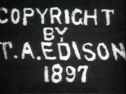 Edison film. 1897 railway hopper car dumper in action.