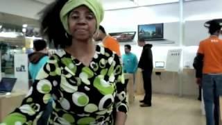 she s dead serious woman doing an african dance inside an apple store