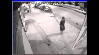 Bushwick gang members walk down the street with rifles