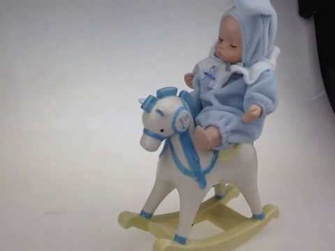 Baby on horse music box