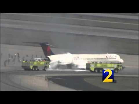 RAW: Delta plane catches fire after landing
