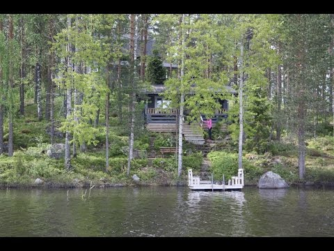 Rock and Lake rental cottage surrounded by lakeside nature, Finland