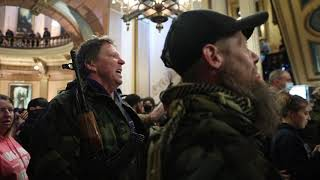 Protesters argue with police inside Michigan Capitol building