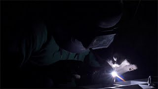 Shot of a worker wearing a helmet and gloves is working with gas welding using copper brazing rod