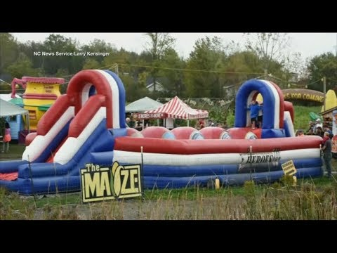 Download Youtube: Inflatable trampoline goes airborne, drags woman