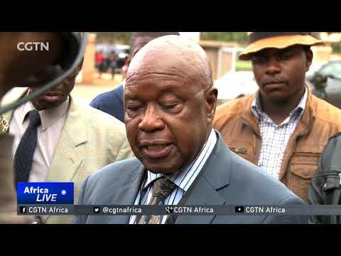 ZANU-PF members cheer during resolution to recall Mugabe