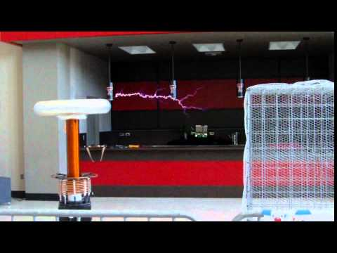 Tesla Coil music - Mario, Zelda, Dr Who, Ghostbusters (turn down volume) - Lubbock Mini Maker Faire