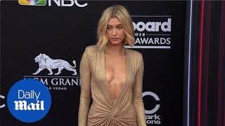 Hailey Baldwin glitters in plunging gold gown at Billboards - Daily Mail