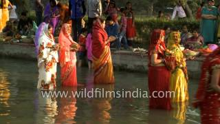 Women of Bihar observe Chhath puja at India Gate, standing in cold water